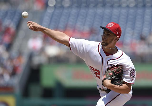 <p>Washington Nationals starting pitcher A.J. Cole delivers a pitch during the first inning of the first baseball game of a split doubleheader against the San Francisco Giants, Sunday, Aug. 13, 2017, in Washington. (AP Photo/Nick Wass) </p>