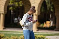 <p>Issa topped wide-leg denim with a Stanford sweatshirt and a Telfar bag. </p>