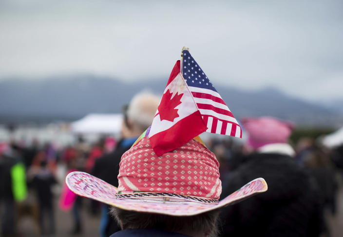 <p>A woman sports Canadian and U.S. flags on her hat during a women's march and protest against U.S. President Donald Trump, in Vancouver, British Columbia on Saturday Jan. 21, 2017. Protests are being held across Canada today in support of the Women's March on Washington. (Darryl Dyck/The Canadian Press via AP) </p>