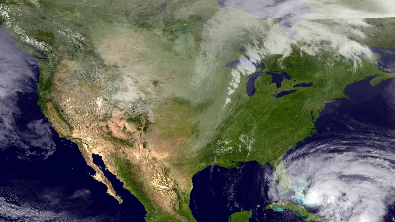 FILE - This NOAA satellite image taken Thursday, Oct. 25, 2012, provided by the National Hurricane Center shows Category 2 Hurricane Sandy moving northward across eastern Cuba. According to the National Oceanic and Atmospheric Administration, the U.S. in 2012 had the second most weather extremes on record, behind 1998. There were 11 different disasters that caused more than $1 billion in damage, including Superstorm Sandy and the drought, NOAA said. (AP Photo/NOAA)