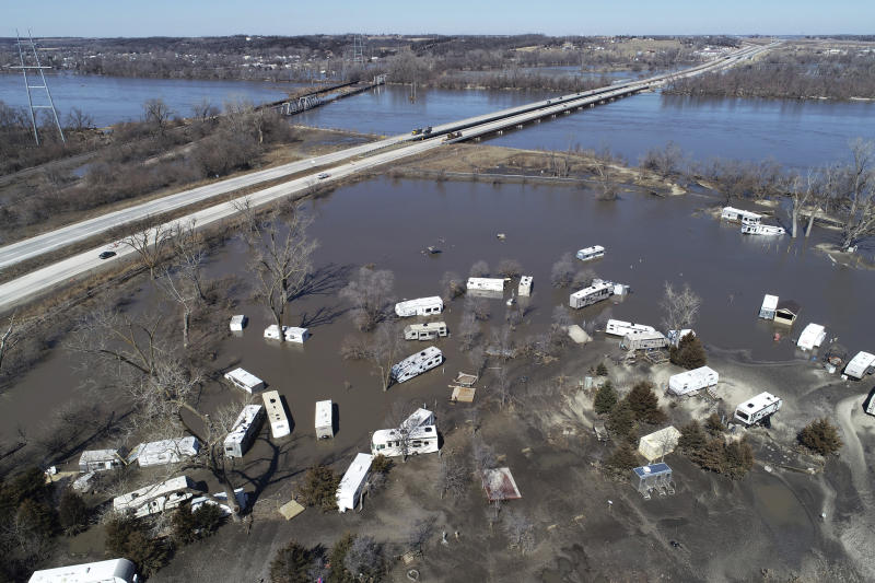 "This Wednesday, March 20, 2019 aerial photo shows flooding near the Platte River in in Plattsmouth, Neb., south of Omaha. The National Weather Service is warning that flooding in parts of South Dakota and northern Iowa could soon reach historic levels. A Weather Service hydrologist says ""major and perhaps historic"" flooding is possible later this month at some spots on the Big Sioux and James rivers. The worst of the flooding so far has been in Nebraska, southwestern Iowa and northwestern Missouri. (DroneBase via AP)"
