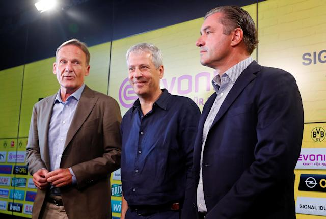 Soccer Football - Borussia Dortmund Press Conference - Signal Iduna Park, Dortmund, Germany - July 6, 2018 Borussia Dortmund Coach Lucien Favre, sporting director Michael Zorc and CEO Hans-Joachim Watzke during the press conference REUTERS/Wolfgang Rattay