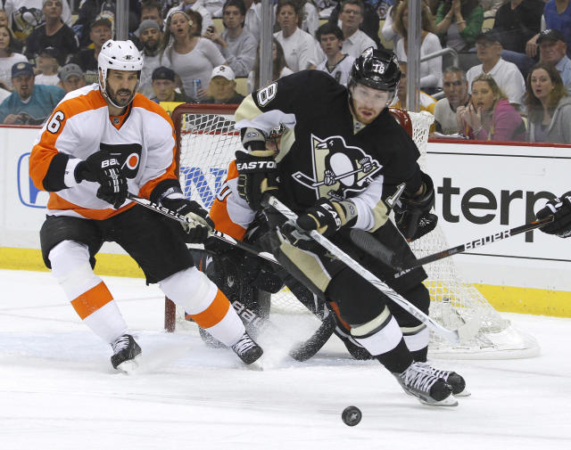 PITTSBURGH, PA - APRIL 20: James Neal #18 of the Pittsburgh Penguins handles the puck against Andreas Lilja #6 of the Philadelphia Flyers in Game Five of the Eastern Conference Quarterfinals during the 2012 NHL Stanley Cup Playoffs at Consol Energy Center on April 20, 2012 in Pittsburgh, Pennsylvania. (Photo by Justin K. Aller/Getty Images)