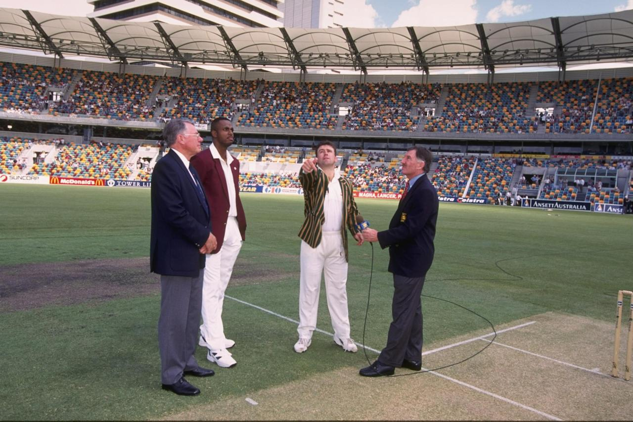 26 Nov 1996:  Captain Courtney Walsh of the West Indies (left) and Mark Taylor, captain of Australia, decide who goes into bat before the start of the first test match between Australia and the West Indies at Brisbane, Australia. Mandatory Credit: ShaunBotterill/Allsport