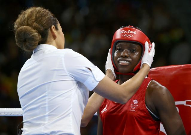 2016 Rio Olympics - Boxing - Final - Women's Fly (51kg) Final Bout 267 - Riocentro - Pavilion 6 - Rio de Janeiro, Brazil - 20/08/2016. Nicola Adams (GBR) of Britain has her headgear adjusted by the referee. REUTERS/Peter Cziborra FOR EDITORIAL USE ONLY. NOT FOR SALE FOR MARKETING OR ADVERTISING CAMPAIGNS.