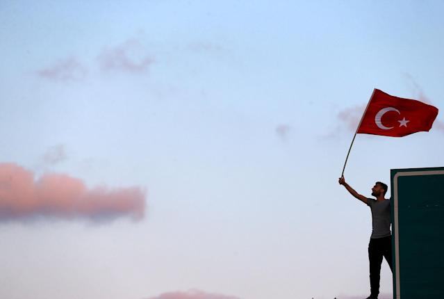 <p>A man waves a Turkey's national flag as he attends a ceremony marking the first anniversary of the attempted coup at the Bosphorus Bridge in Istanbul, Turkey July 15, 2017. (Photo: Osman Orsal/Reuters) </p>