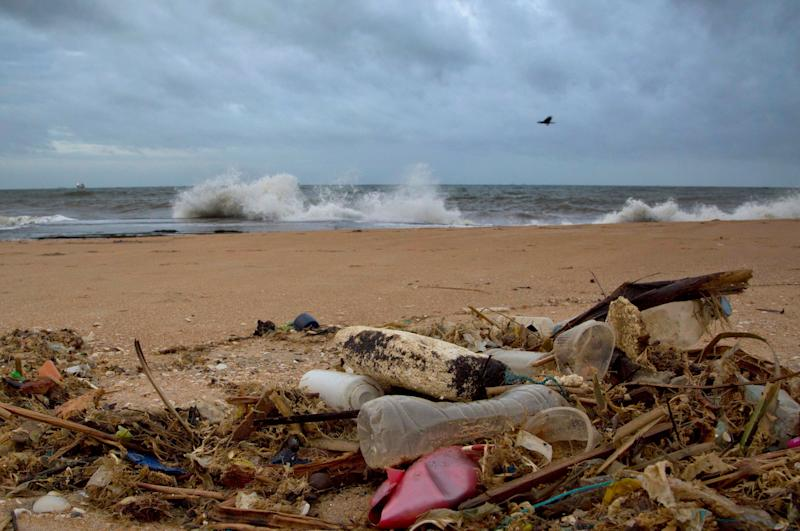 In a file photo, debris is seen washed ashore on a beach in Sri Lanka. According to a report from the United Nations released on March 13, 2019, climate change, a global major extinction of animals and plants, degraded land, polluted air, and plastics, pesticides and hormone-changing chemicals in the water are making the planet an increasing unhealthy place for people.
