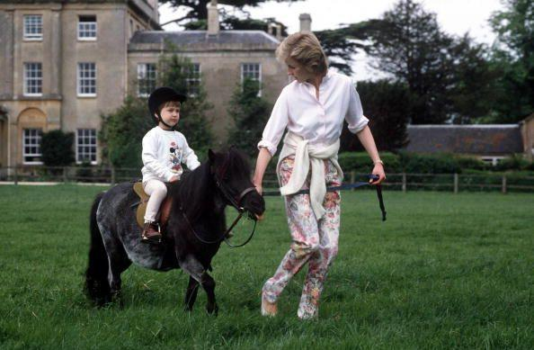<p>At Highgrove House (the family home of Prince Charles), Prince William spends a summer afternoon riding his pony with a little bit of help from his mother in 1986. </p>