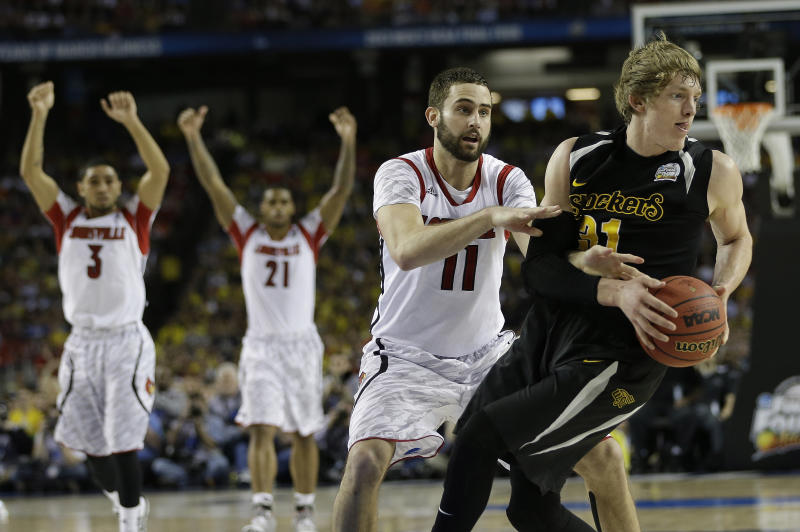 Wichita State's Ron Baker (31) and Louisville's Luke Hancock move during the second half of the NCAA Final Four tournament college basketball semifinal game Saturday, April 6, 2013, in Atlanta. Louisville won 72-68. (AP Photo/David J. Phillip)