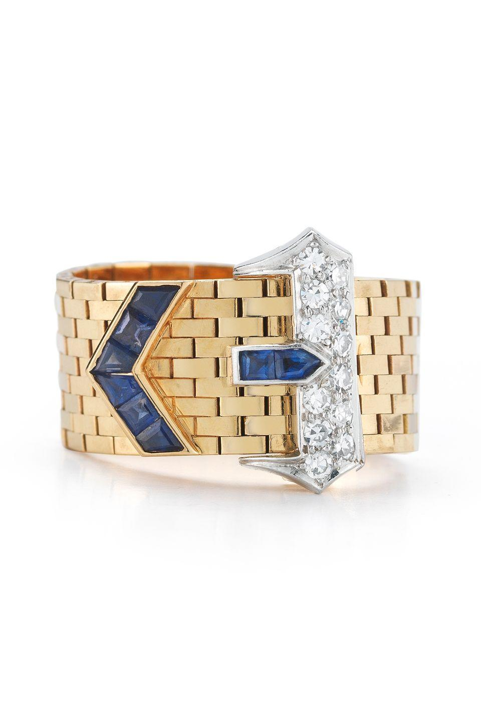 "<p><em><strong>McTeigue & McClelland </strong>Diamond and Blue Sapphire Ring in 18 Karat Mesh With Platinum Buckle, circa 1945-1950, price upon request, <a href=""http://www.mc2jewels.com/"" rel=""nofollow noopener"" target=""_blank"" data-ylk=""slk:mc2jewels.com"" class=""link rapid-noclick-resp"">mc2jewels.com</a></em></p><p><a class=""link rapid-noclick-resp"" href=""http://www.mc2jewels.com/"" rel=""nofollow noopener"" target=""_blank"" data-ylk=""slk:SHOP"">SHOP</a></p>"