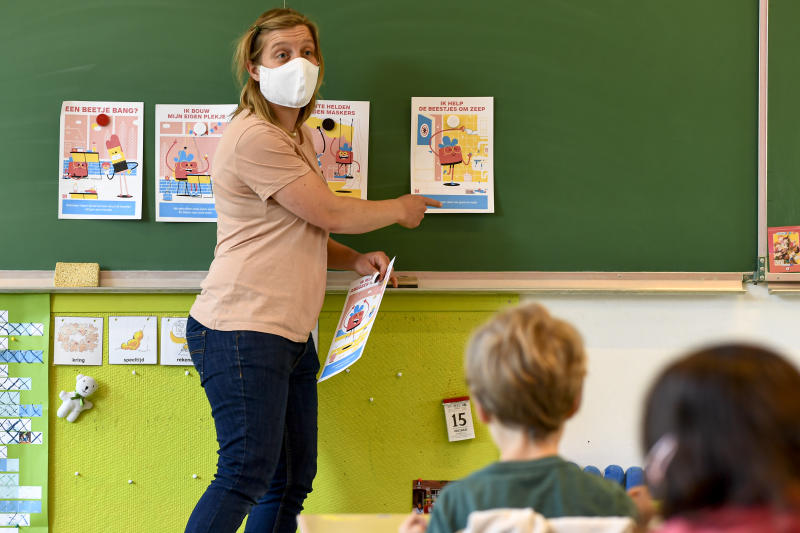 Illustration picture shows a teacher wearing a face mask at the gradual re-opening of Olfa Elsdonk primary school in Edegem, Antwerp, Friday 15 May 2020. Belgium is in its ninth week of confinement. Schools will test the re-opening on Friday 15 May and start again for a limited number of grades on Monday 18 May. BELGA PHOTO DIRK WAEM (Photo by DIRK WAEM/BELGA MAG/AFP via Getty Images)