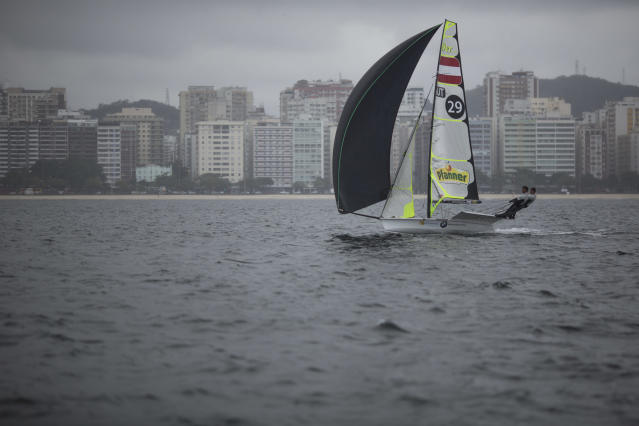 Austria's 49er class Benjamin Bildstein and David Hussl, train on the waters of Guanabaray bay between Niteroi and Rio de Janeiro, Brazil, Sunday, July 27, 2014. International sailors are gathering for the first test event of the 2016 Olympics in Rio de Janeiro, concerned about water pollution in Guanabara Bay that some have likened to a sewer. (AP Photo/Felipe Dana)