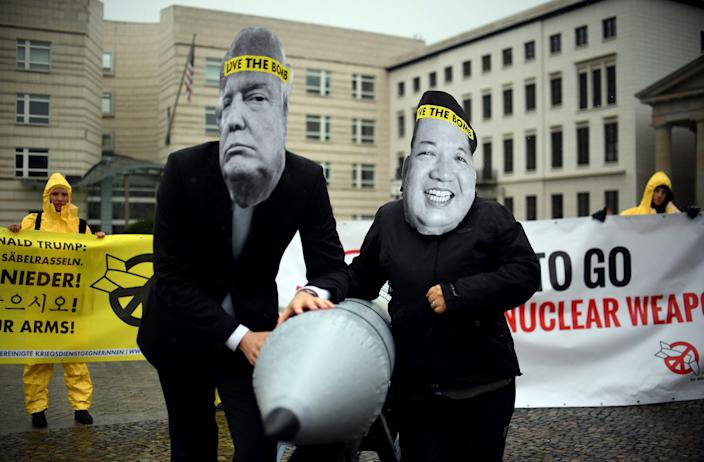 Protesters wearing masks of President Donald Trump and North Korean leader Kim Jong Un in 2017 in front of the U.S. Embassy in Berlin.