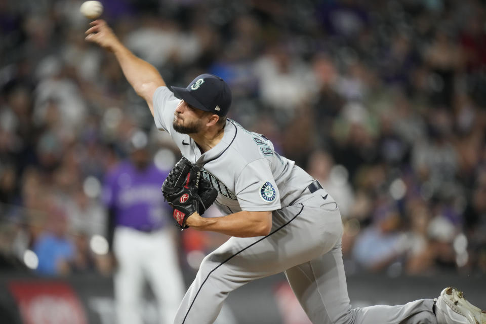 Seattle Mariners relief pitcher Kendall Graveman works against the Colorado Rockies during the ninth inning of a baseball game Tuesday, July 20, 2021, in Denver. The Mariners won 6-4. (AP Photo/David Zalubowski)