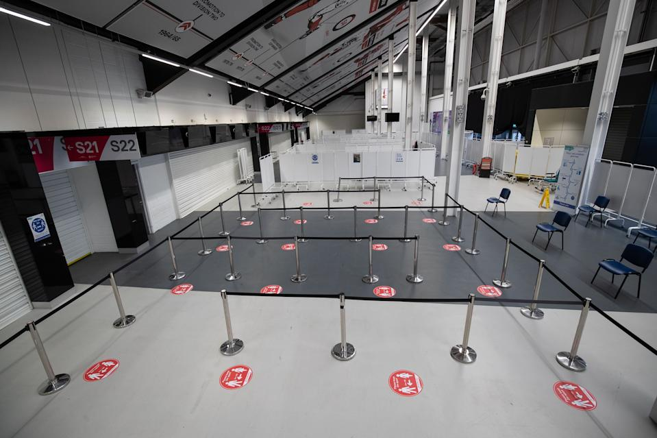 A general view shows a queuing area at the vaccination centre inside Ashton Gate Stadium in Bristol on January 9, 2021 one of seven mass vaccination centres which are set to open next week as Britain continues its vaccination programme against Covid-19. - Ashton Gate is one of the seven seven mass vaccination hubs opening around the country from next week. UK health officials and ministers have described the vaccination roll-out as a head-to-head race against the virus and the vaccination programme as the best hope of a return to normality. (Photo by Andrew Matthews / POOL / AFP) (Photo by ANDREW MATTHEWS/POOL/AFP via Getty Images)