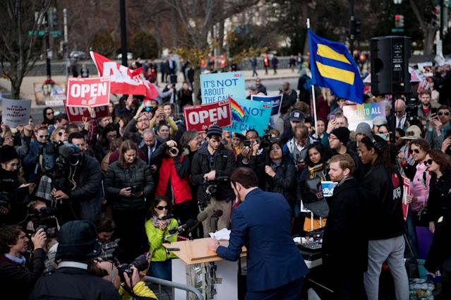 <p>Charlie Craig speaks to supporters outside the US Supreme Court as Masterpiece Cakeshop vs. Colorado Civil Rights Commission is heard on Dec. 5, 2017 in Washington. (Photo: Brendan Smialowski/AFP/Getty Images) </p>