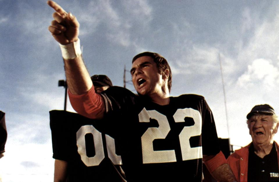 <p>Before he began acting, Reynolds eyed a career playing professional football. After an injury sidelined him while he was playing in college at Florida State, he pursued other options. Perhaps that's why his portrayal of a former footballer, Paul Crewe, in the 1974 film was so darn good. (Photo:<br>Paramount Pictures/Courtesy of Everett) </p>