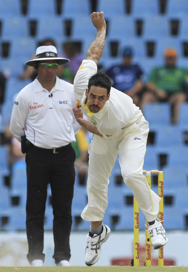 Australia's bowler Mitchell Johnson follows through his delivery against Australia as umpire Aleem Dar of Pakistan, left, watches him on the fourth day of their cricket test match at Centurion Park in Pretoria, South Africa, Saturday, Feb. 15, 2014. (AP Photo/ Themba Hadebe)