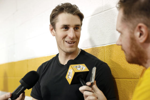 Nashville Predators center Kyle Turris answers questions as players report to NHL hockey training camp Thursday, Sept. 12, 2019, in Nashville, Tenn. (AP Photo/Mark Humphrey)
