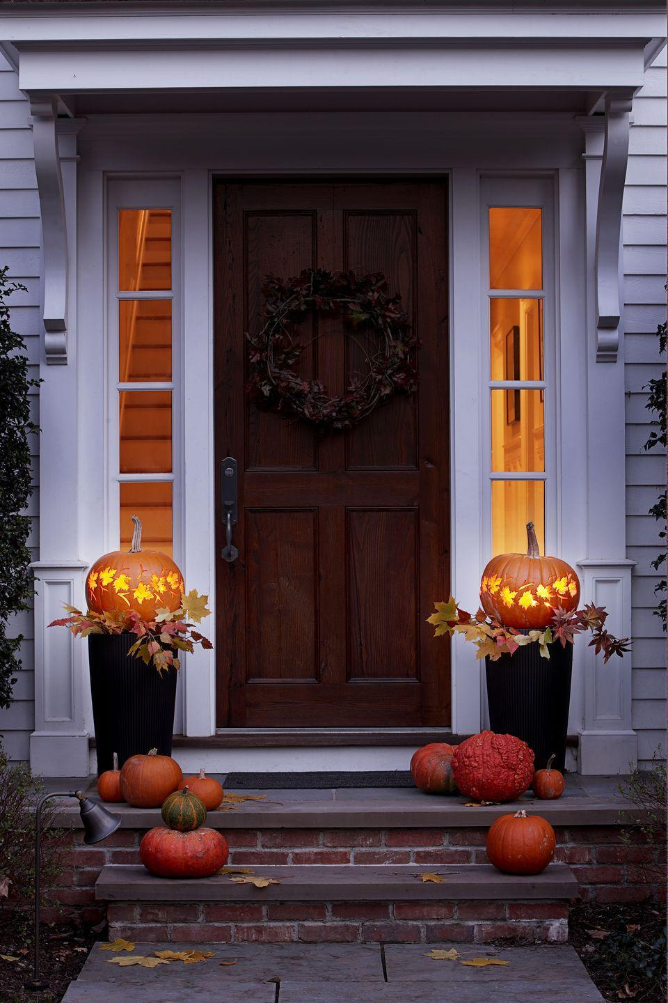 """<p>A textured branch wreath is suitable for the fall season, but it's also brilliant for Halloween when paired with a chic pumpkin collection. <br><br><a class=""""link rapid-noclick-resp"""" href=""""https://go.redirectingat.com?id=74968X1596630&url=https%3A%2F%2Fwww.michaels.com%2F18in-grapevine-wreath-by-ashland%2F10375477.html&sref=https%3A%2F%2Fwww.goodhousekeeping.com%2Fholidays%2Fhalloween-ideas%2Fg32948621%2Fhalloween-door-decorations%2F"""" rel=""""nofollow noopener"""" target=""""_blank"""" data-ylk=""""slk:SHOP GRAPEVINE WREATH"""">SHOP GRAPEVINE WREATH</a></p>"""