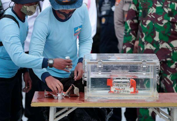 PHOTO: Indonesian Navy personnel arrange parts of the flight data recorder of Sriwijaya Air Flight 182, retrieved from the Java Sea where the jet crashed, during a press conference at the Port of Tanjung Priok in Jakarta, Indonesia, on Jan. 12, 2021. (Dita Alangkara/AP)