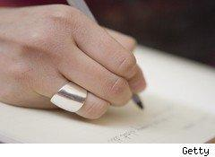 hand of a writer with pen