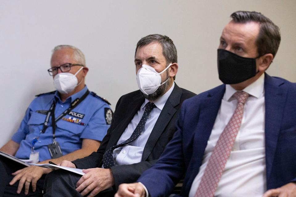 Chief Health Officer Dr Andrew Robertson (centre) seen with Premier Mark McGowan Sunday. Source: AAP