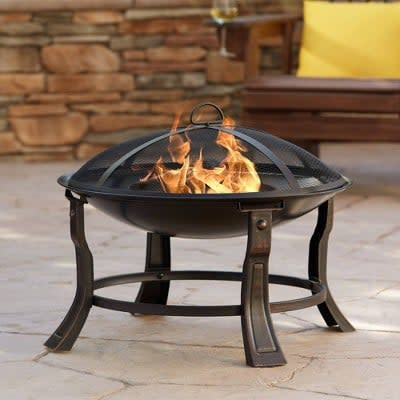 <p>If you have a small space, this <span>John Timberland Black Iron Outdoor Fire Pit</span> ($100) fill fit right in.</p>