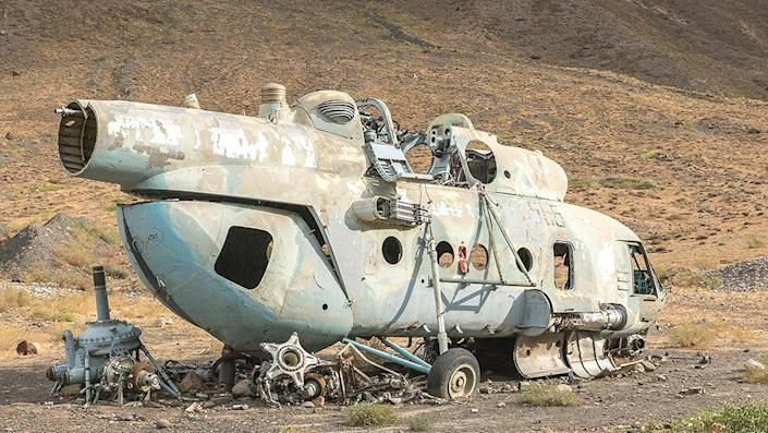 Rusting helicopter from Soviet invasion of Afghanistan in 1979, Panjshir Valley, Afghanistan, 2015