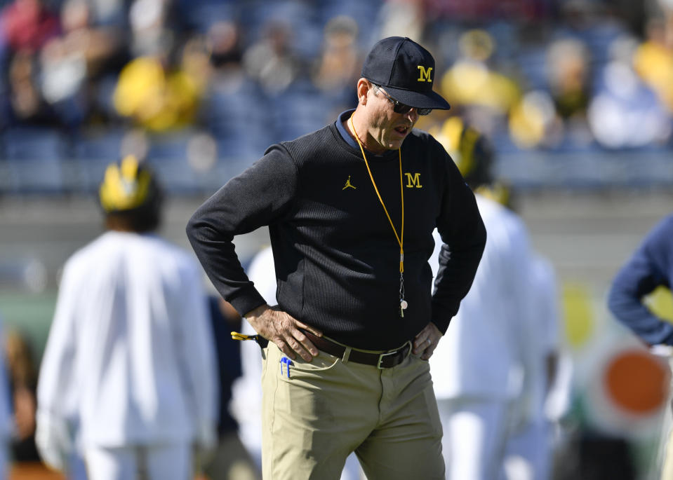 Michigan coach Jim Harbaugh looks down prior to the first half of the Citrus Bowl between Michigan and Alabama on Jan. 01, 2020. (Roy K. Miller/Icon Sportswire via Getty Images)