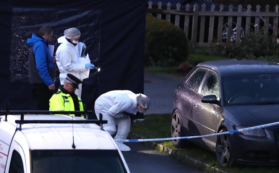 Police combing the crime scene for evidence. (PA)