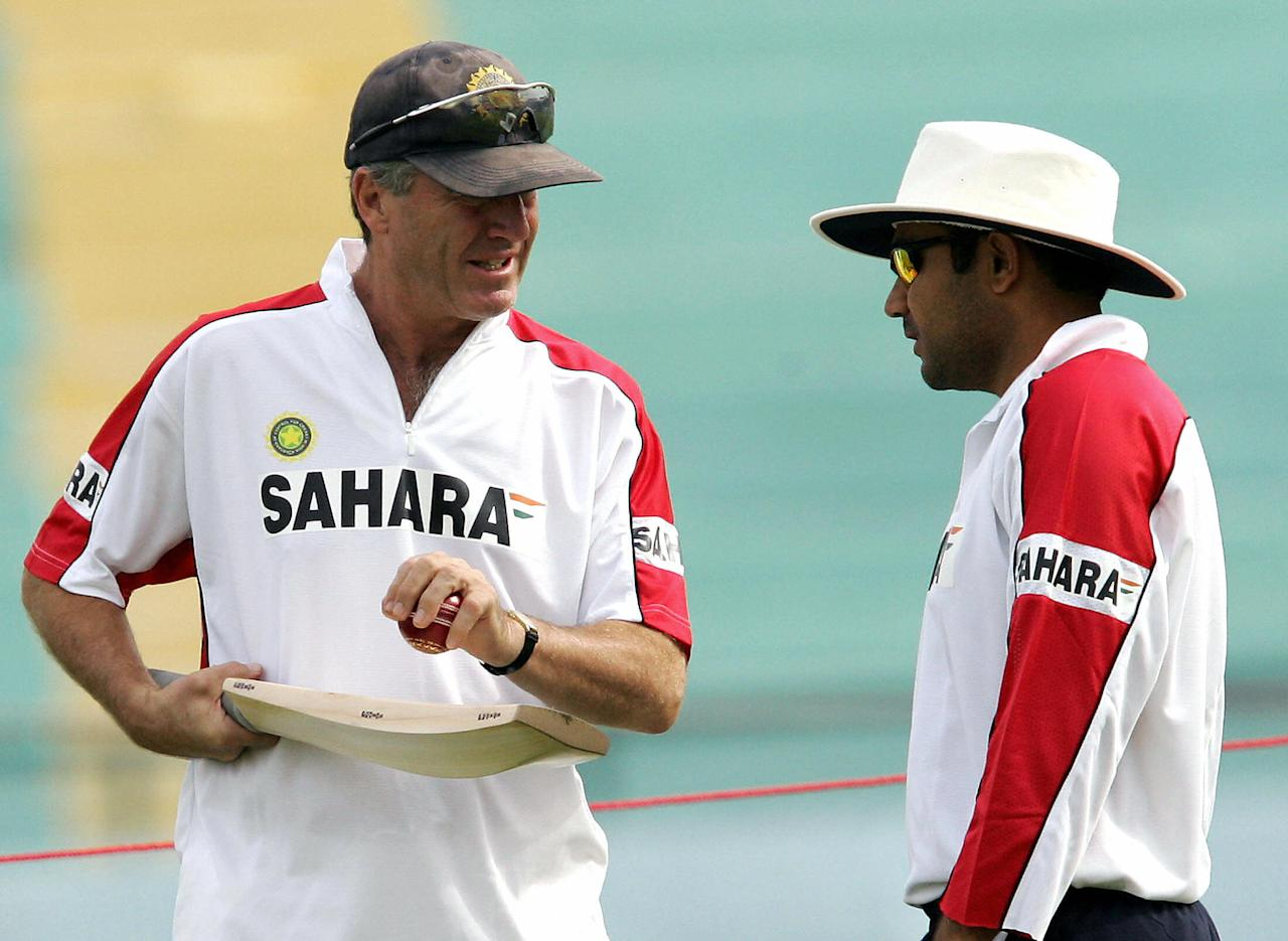 MOHALI, INDIA:  Indian cricket team coach John Wright (L) gives batting tips to cricketer Virender Sehwag during a net practice session at the Punjab Cricket Association (PCA) Stadium in Mohali, 07 March 2005, on the eve of the first Test match against Pakistan.    India's captain Sourav Ganguly has at his disposal a full-strength bowling attack as seamers Laxmipathy Balaji and Ashish Nehra have returned after being out of Test cricket for nearly a year due to injuries. Pakistan captain Inzamam-ul-Haq said  India would plan to capitalise on the absence of his key paceman Shoaib Akhtar by preparing a fast track for the opening test match.  AFP PHOTO/Prakash SINGH  (Photo credit should read PRAKASH SINGH/AFP/Getty Images)