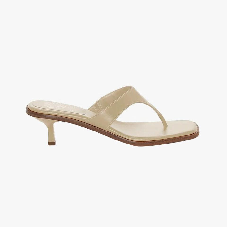 "$89, VINCE CAMUTO. <a href=""https://www.vincecamuto.com/en/us/product/vince-camuto-cannetta-thong-sandal/8200000000513082?activeColor=102"" rel=""nofollow noopener"" target=""_blank"" data-ylk=""slk:Get it now!"" class=""link rapid-noclick-resp"">Get it now!</a>"