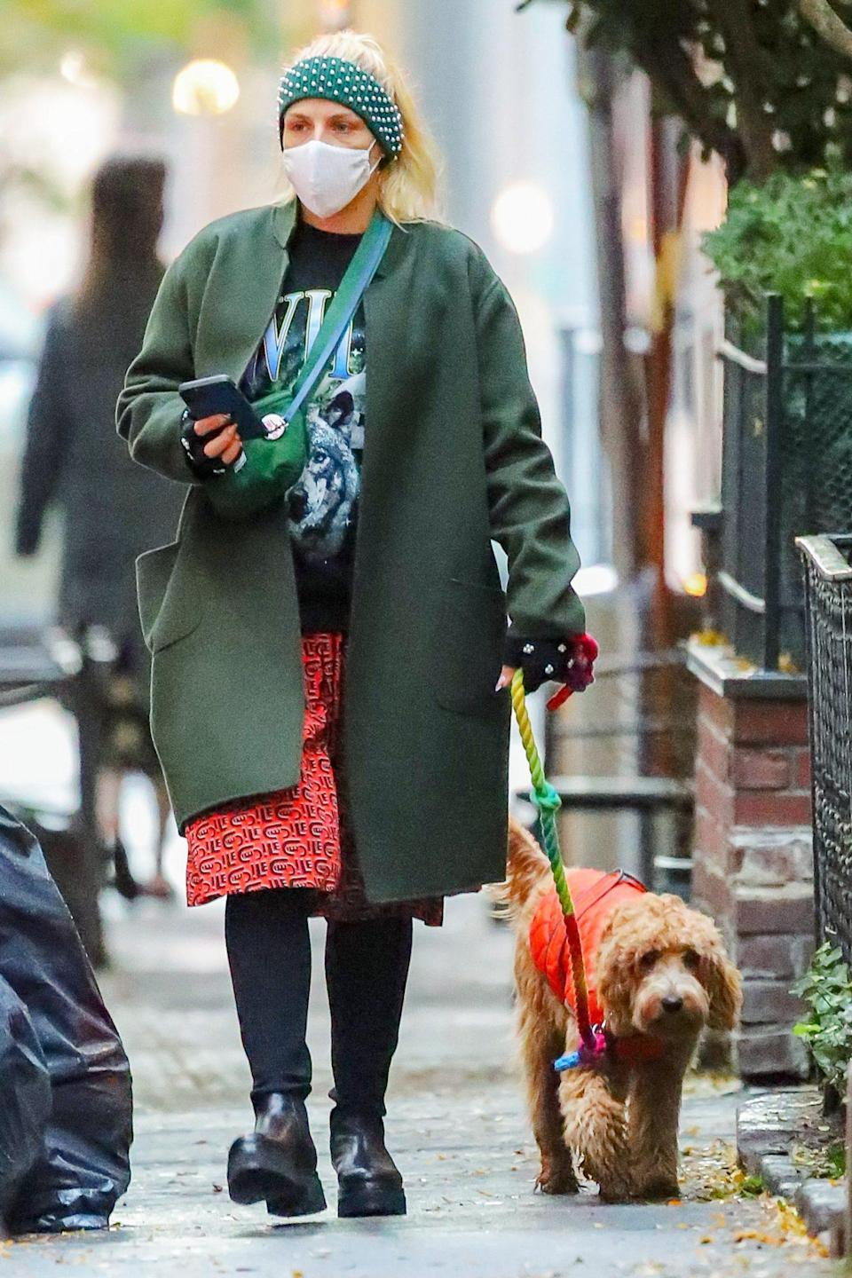 <p>Busy Philipps steps out in a layered look for a walk with her dog around N.Y.C. on Friday.</p>