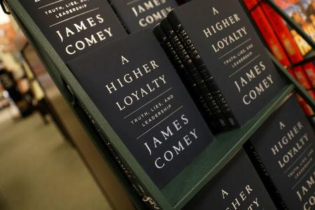 "Copies of James Comey's book ""A Higher Loyalty"" are pictured in a book store in the Manhattan borough of New York City, New York, U.S., April 17, 2018. REUTERS/Mike Segar"