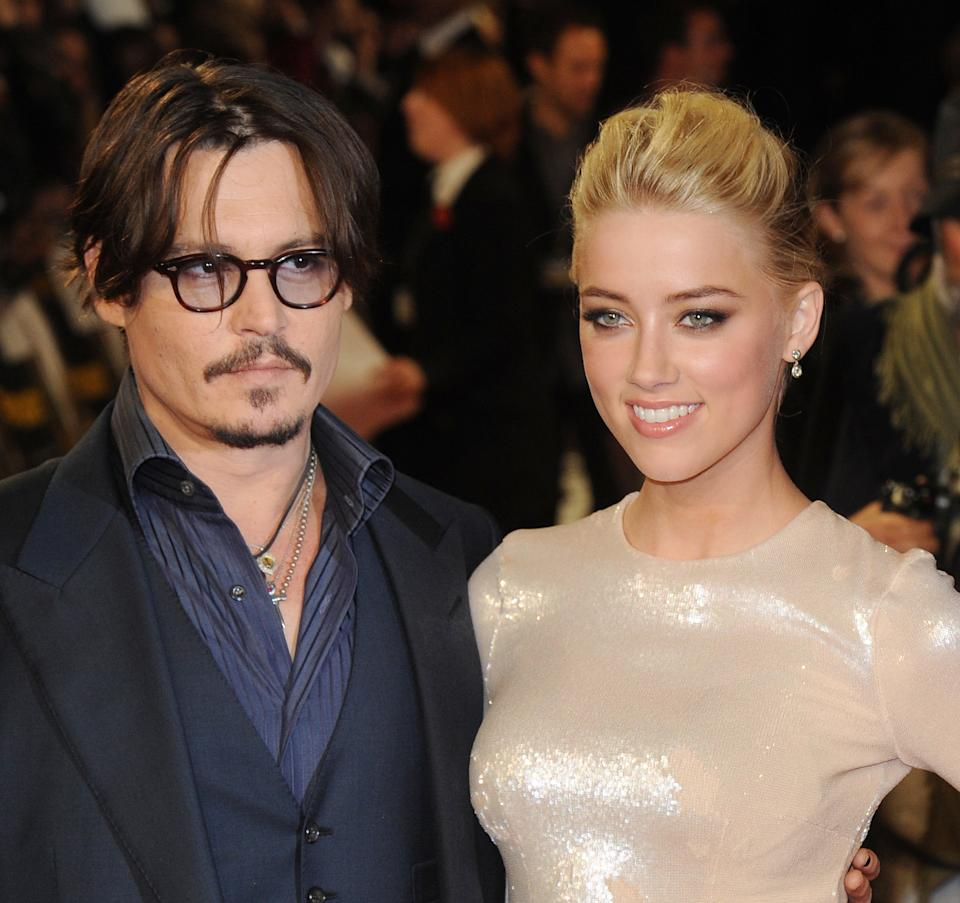 """Johnny Depp and Amber Heard attend the premiere of """"Rum Diary"""" at Odeon, Kensington. (Photo by Rune Hellestad/Corbis via Getty Images)"""