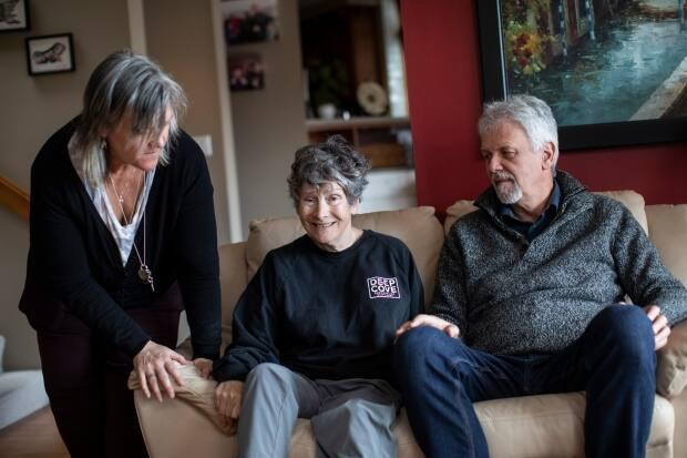 Dale Shearar, middle, with her husband Stewart Shearar, right, and caregiver Eryn Arnott at the Shearars' home in North Vancouver on Thursday.  (Ben Nelms/CBC - image credit)