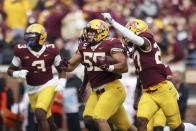 Minnesota linebacker Mariano Sori-Marin (55) celebrates with teammates after intercepting the ball against Bowling Green during an NCAA college football game Saturday, Sept. 25, 2021, in Minneapolis. (AP Photo/Stacy Bengs)