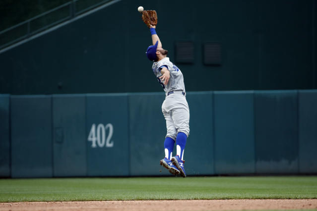 Los Angeles Dodgers shortstop Chris Taylor can't catch a hit by Washington Nationals' Wilmer Difo for a single during the third inning of the first baseball game of a doubleheader at Nationals Park, Saturday, May 19, 2018, in Washington. (AP Photo/Alex Brandon)