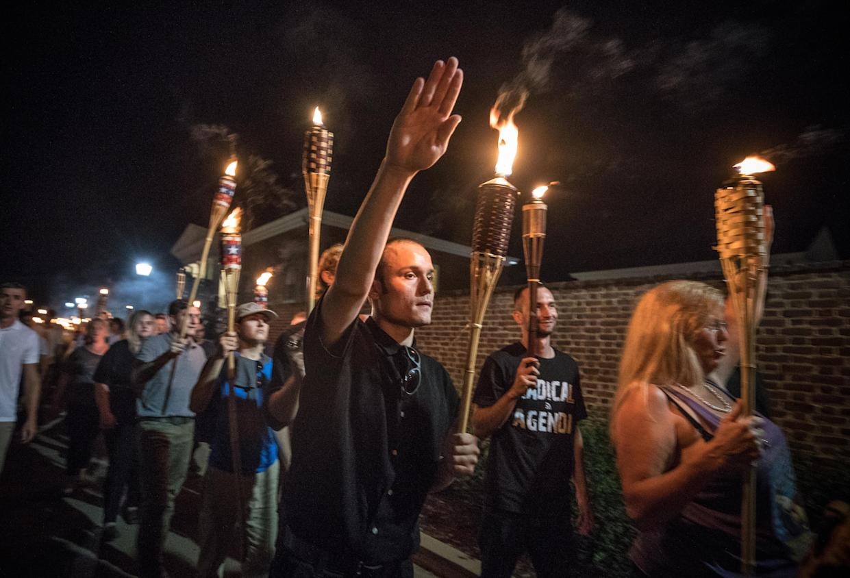 """Chanting """"White lives matter! You will not replace us! and Jews will not replace us!,"""" several hundred white nationalists and white supremacists with torches march through the University of Virginia campus on Aug. 11, 2017. (Photo: Evelyn Hockstein/For The Washington Post via Getty Images)"""