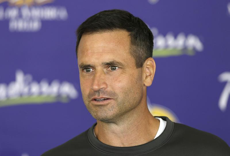In this July 27, 2013, photo, Minnesota Vikings special teams coordinator Mike Priefer speaks to reporters following practice at NFL football training camp in Mankato, Minn. Former Minnesota punter Chris Kluwe says Priefer made anti-gay comments while Kluwe was with the Vikings. Kluwe wrote a scathing article on the website Deadspin on Thursday, Jan. 2, 2014. In it, he alleges that Priefer made several anti-gay comments in objection to Kluwe's outspoken support of a gay marriage amendment in Minnesota. Kluwe also said coach Leslie Frazier and general manager Rick Spielman encouraged him to tone down his public rhetoric on gay marriage and several other issues. Kluwe was cut last summer and did not play in the NFL this season. The Vikings issued a statement saying they take the allegations seriously. They also say he was released because of his football performance, not something else. (AP Photo/Charlie Neibergall)