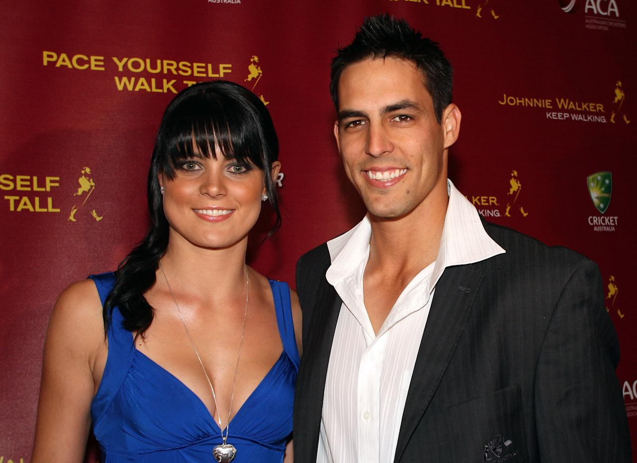 BRISBANE, AUSTRALIA - NOVEMBER 17: Mitchell Johnson and his partner Jessica Bratich attend the Johnnie Walker All Star Party at the Gallery of Modern Art, on November 17, 2008 in Brisbane, Australia.  (Photo by Bradley Kanaris/Getty Images)