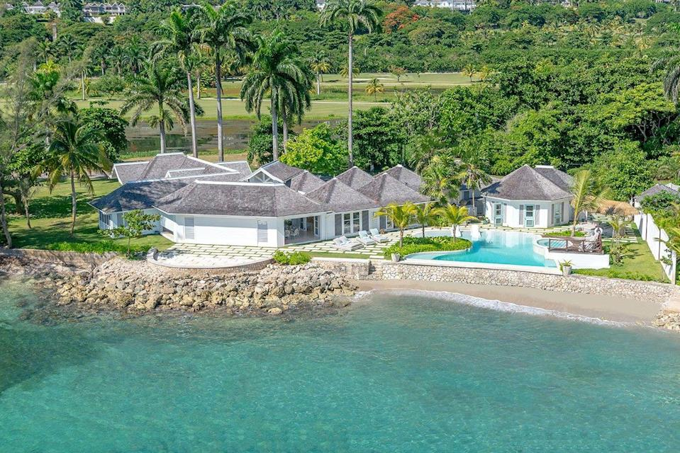 """<p>This summer deserves an extra-special getaway, and we've found just the destination: this sprawling oceanfront estate in Montego Bay that houses a private beach. Tradewinds on the Sea is one of <a href=""""https://tryallclub.com/"""" rel=""""nofollow noopener"""" target=""""_blank"""" data-ylk=""""slk:The Tryall Club"""" class=""""link rapid-noclick-resp"""">The Tryall Club</a>'s most impressive villas, offering the best of both worlds with total seclusion and access to all the resort's amenities. This four-bedroom home features a heated walk-in infinity pool, a spectacular indoor-outdoor living setup, eight-person hot tub, and a full staff to help assist in your stay, be it cooking, doing laundry, or helping you book a reservation at the spa or a favorite resort restaurant.</p><p><a class=""""link rapid-noclick-resp"""" href=""""https://tryallclub.com/villa/tradewinds-on-the-sea/?bed=all"""" rel=""""nofollow noopener"""" target=""""_blank"""" data-ylk=""""slk:Book Now"""">Book Now</a></p>"""