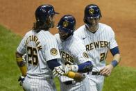 Milwaukee Brewers' Ryan Braun celebrates his three-run home run with Jacob Nottingham (26) and Christian Yelich during the eighth inning of a baseball game against the Kansas City Royals Saturday, Sept. 19, 2020, in Milwaukee. (AP Photo/Morry Gash)