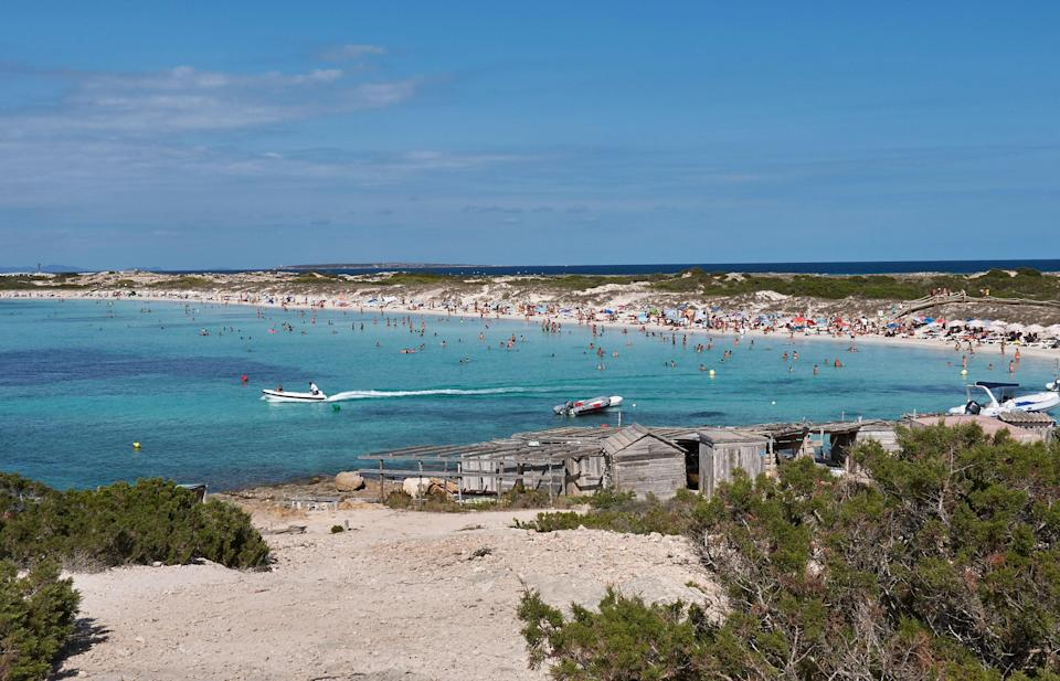 """Located on the tiny Balearic island of Formentera, Platja de Ses Illetes is nearly a dead ringer for the <a href=""""https://www.cntraveler.com/galleries/2016-03-02/most-beautiful-islands-in-the-caribbean?mbid=synd_yahoo_rss"""" rel=""""nofollow noopener"""" target=""""_blank"""" data-ylk=""""slk:Caribbean"""" class=""""link rapid-noclick-resp"""">Caribbean</a> with its luminous white sand and brilliant turquoise waters. Set within Ses Salines Natural Park, a protected reserve filled with hidden beaches, salt flats, and wetlands, this stretch of sand offers a peaceful alternative to the crowded, boisterous beaches on neighboring <a href=""""https://www.cntraveler.com/story/aerin-lauder-keeps-going-back-to-ibiza?mbid=synd_yahoo_rss"""" rel=""""nofollow noopener"""" target=""""_blank"""" data-ylk=""""slk:Ibiza"""" class=""""link rapid-noclick-resp"""">Ibiza</a>."""