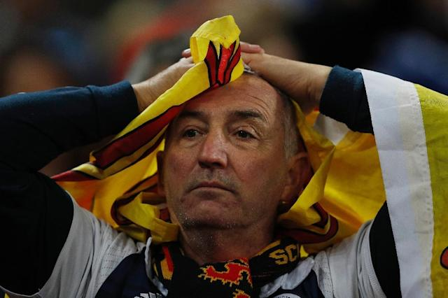 Scottish fans react after losing 3-0 a World Cup 2018 qualification match between England and Scotland at Wembley stadium in London on November 11, 2016 (AFP Photo/Adrian Dennis)