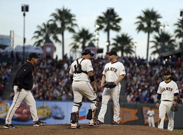 San Francisco Giants' Chad Gaudin, third from left, is visited by pitching coach Dave Righetti, left, and catcher Guillermo Quiroz (12) in the third inning of a baseball game against the Cincinnati Reds on Wednesday, July 24, 2013, in San Francisco. (AP Photo/Ben Margot)