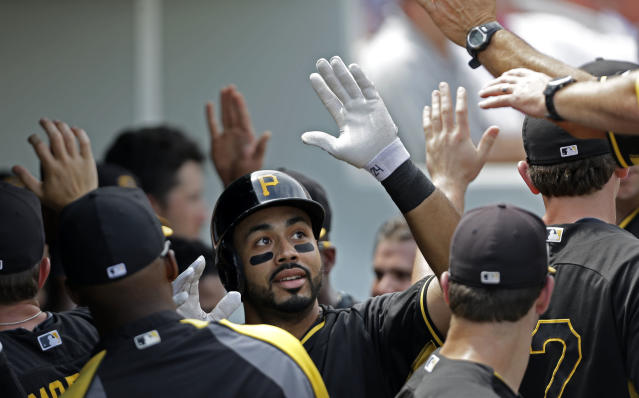 Pittsburgh Pirates third baseman Pedro Alvarez is greeted in the dugout after his two-run homer in the third inning of an exhibition baseball game against the Minnesota Twins in Fort Myers, Fla., Wednesday, March 12, 2014. (AP Photo/Gerald Herbert)