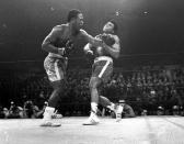 FILE - In this March 8, 1971, file photo, boxer Joe Frazier, left, hits Muhammad Ali during the 15th round of their heavyweight title fight at New York's Madison Square Garden. (AP Photo/File)