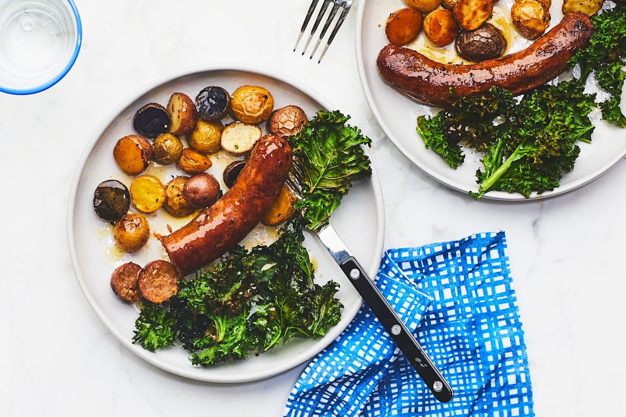 """With crispy mini potatoes and hearty greens that are roasted in a sweet-tart mustard dressing, this 25-minute dinner is an easy Friday night dinner. <a href=""""https://www.epicurious.com/recipes/food/views/sausage-and-greens-sheet-pan-dinner?mbid=synd_yahoo_rss"""">See recipe.</a>"""
